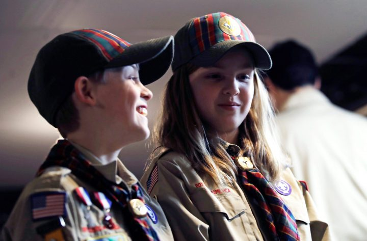In a Thursday, March 1, 2018 photo, Ian Weir, left, smiles as he stands with his twin sister Tatum after a cub scout meeting in Madbury, N.H.
