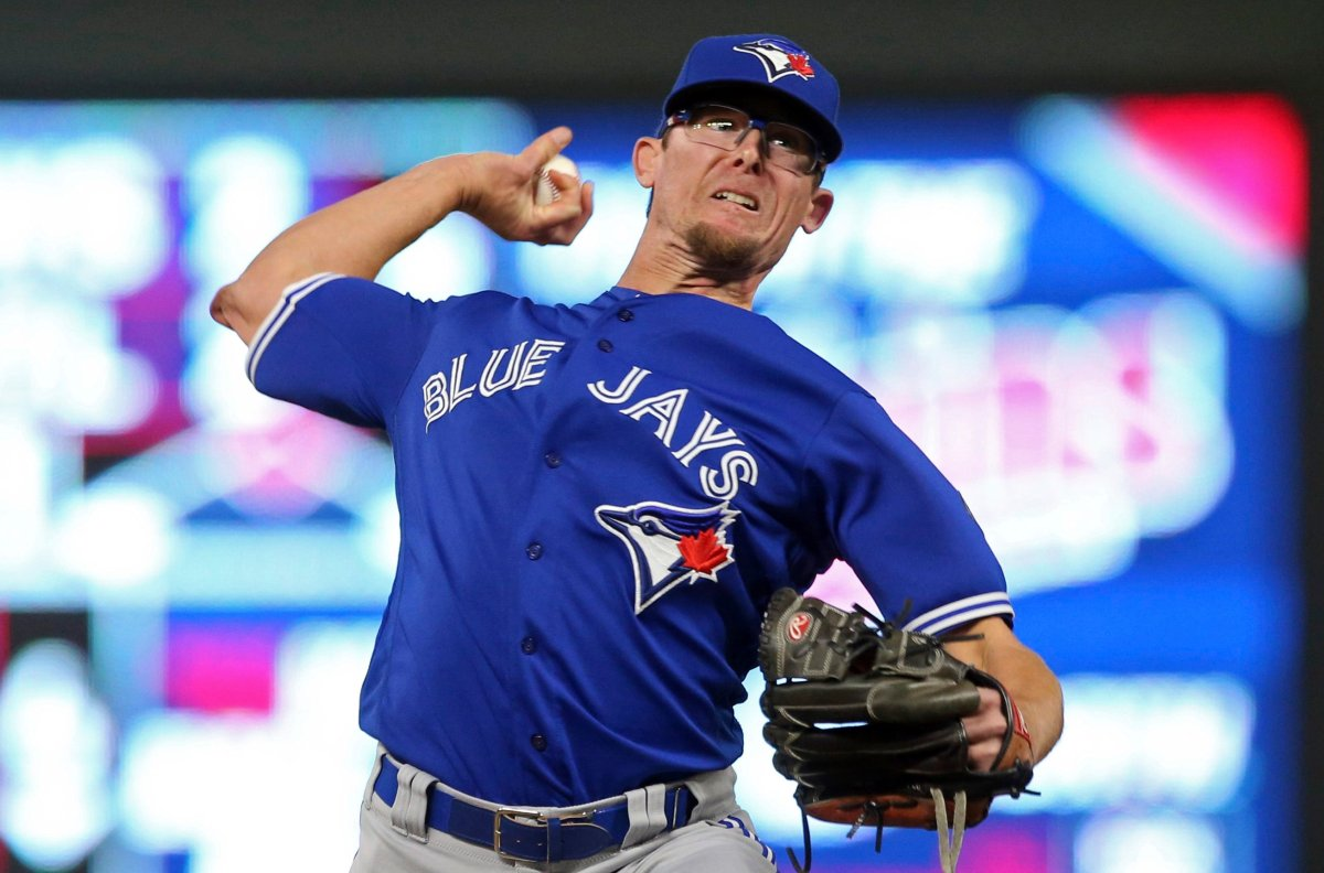 Toronto Blue Jays pitcher Tyler Clippard throws to a Minnesota Twins batter during the ninth inning of a baseball game Tuesday, May 1, 2018, in Minneapolis. The Blue Jays won 7-4 in 10 innings, with Clippard picking up the win.