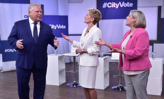 Liberal Premier Kathleen Wynne, Progressive Conservative Leader Doug Ford and NDP Leader Andrea Horwath take part in the Ontario Leaders debate in Toronto, May 7, 2018.