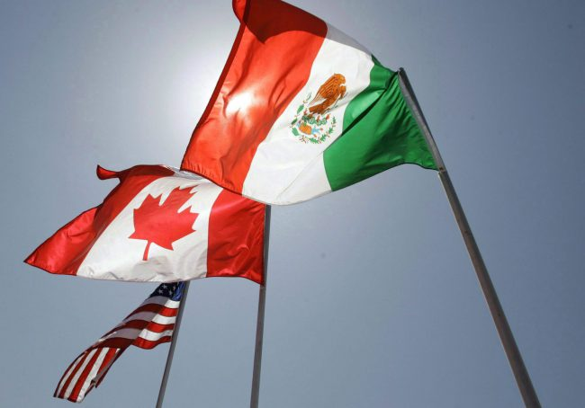 In this April 21, 2008 file photo, national flags of the United States, Canada, and Mexico fly in the breeze in New Orleans.