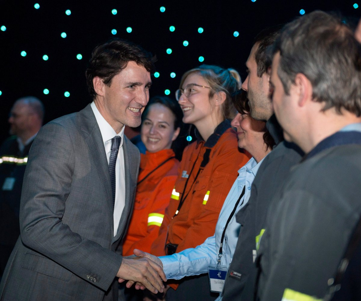 Prime Minister Justin Trudeau is greeted by aluminum plant workers at an announcement on clean aluminum smelting technology, Thursday, May 10, 2018 in Saguenay, Que. Those workers will soon be voters in a byelection Trudeau is expected to call as early as this weekend.