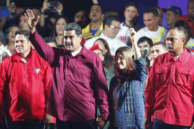 Venezuela's President Nicolas Maduro and his wife Cilia Flores wave to supporters after the National Electoral Council said he was re-elected in a vote marred by opposition boycott in Caracas, Venezuela, May 20, 2018.
