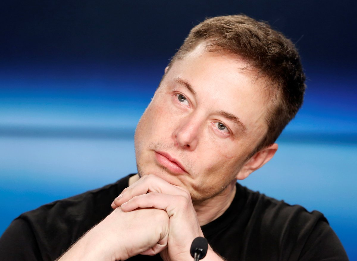 FILE — Elon Musk listens at a press conference following the first launch of a SpaceX Falcon Heavy rocket at the Kennedy Space Center in Cape Canaveral, Florida, U.S., February 6, 2018.