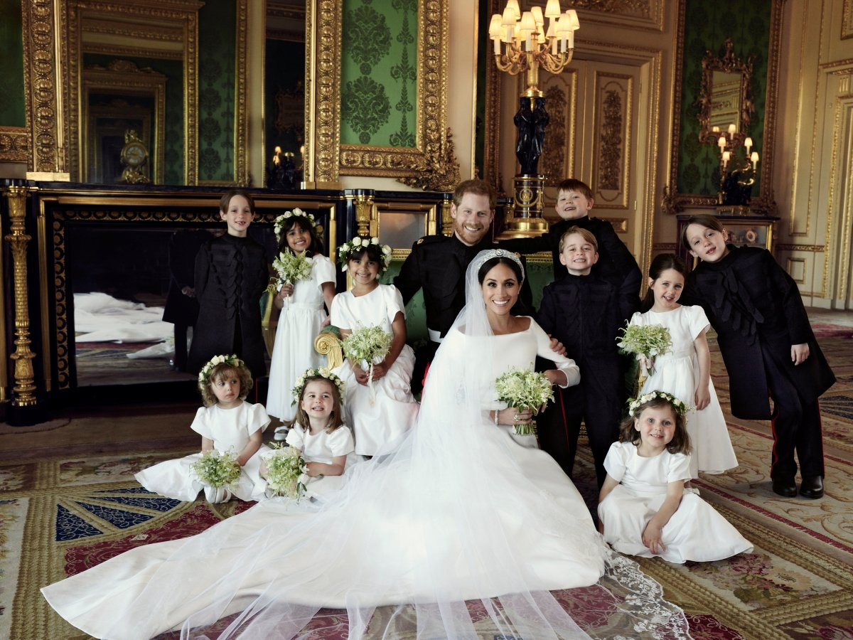 Prince Harry and Meghan Markle pose for a photo at Windsor Castle following their wedding.