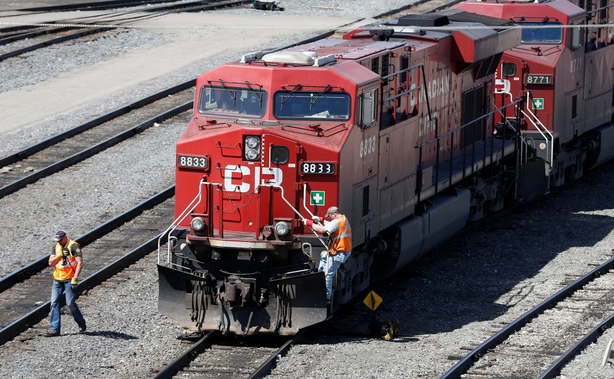 FILE — A Canadian Pacific Railway crew works on their train at the CP Rail yards in Calgary, Alberta.