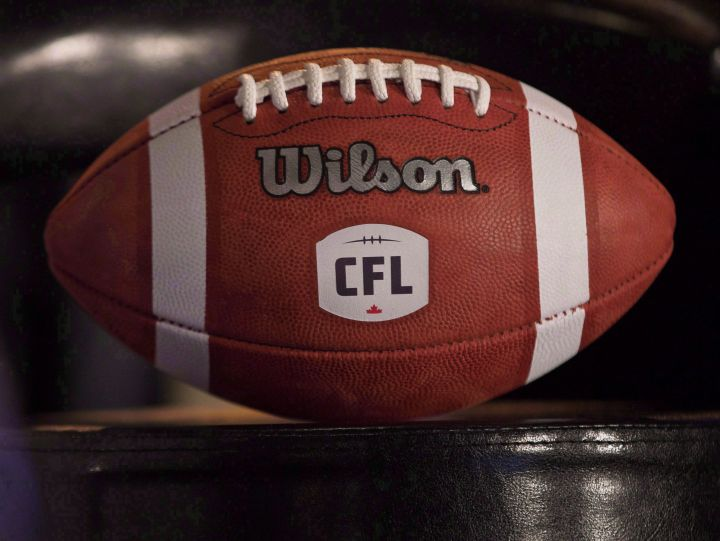 A football with the new CFL logo sits on a chair during a press conference in Winnipeg, Friday, November 27, 2015. The CFL Players' Association has filed a grievance against the CFL related to player safety and rehabilitation.