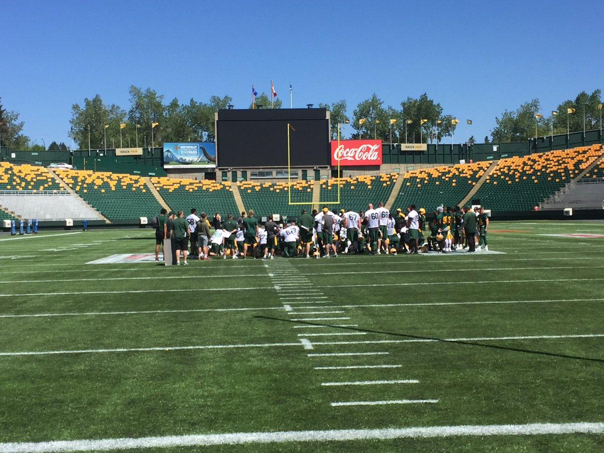 The Edmonton Eskimos huddle up after the opening day of training camp on The Brick Field at Commonwealth Stadium.