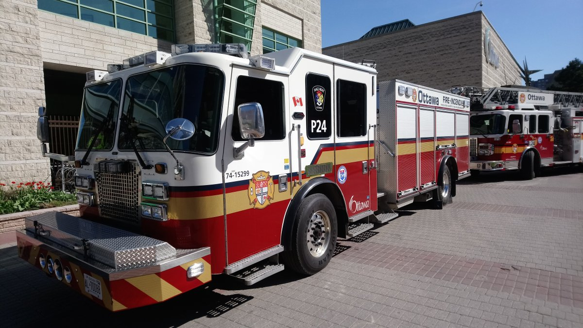 Ottawa fire says a woman is in critical condition after being trapped under a minivan in Riverside South on Tuesday afternoon.