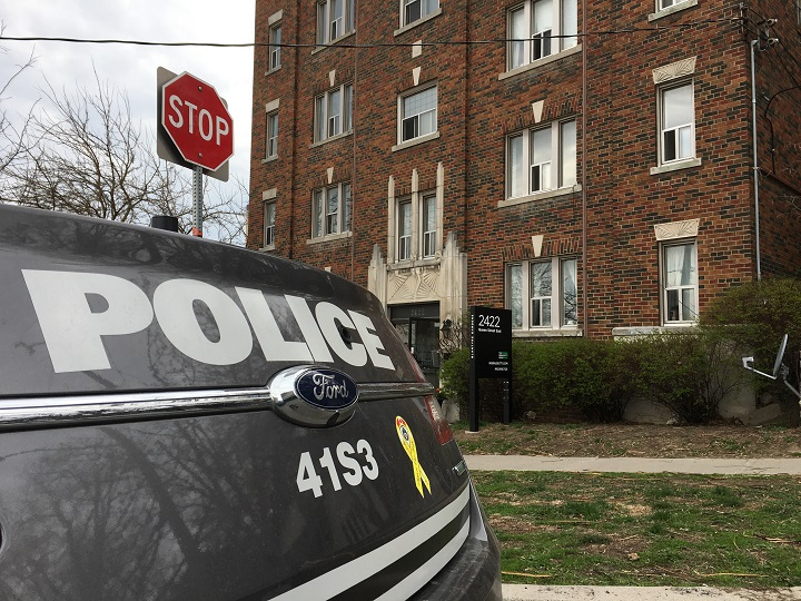 A Toronto police cruiser sits outside a building in Toronto.