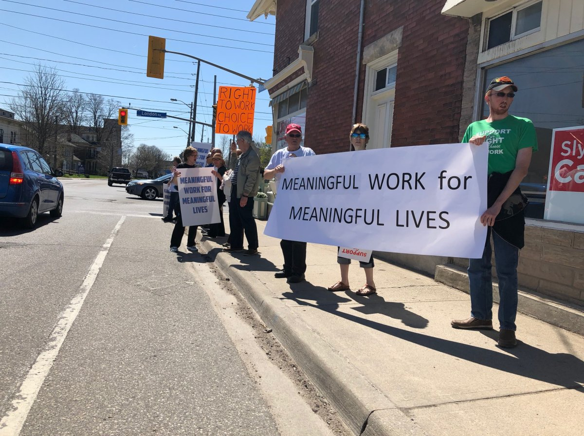 Protesters rally outside the office of Sly Castaldi, Guelph's Liberal candidate in the upcoming provincial election.