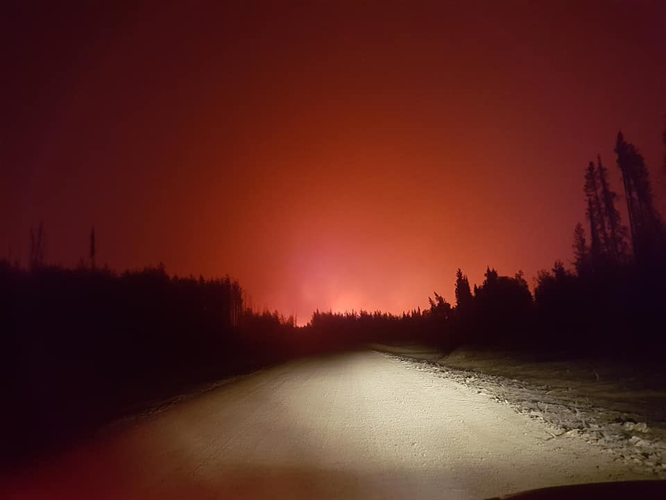 The night sky glows red as wildfires threaten Little Grand Rapids May 23, 2018.