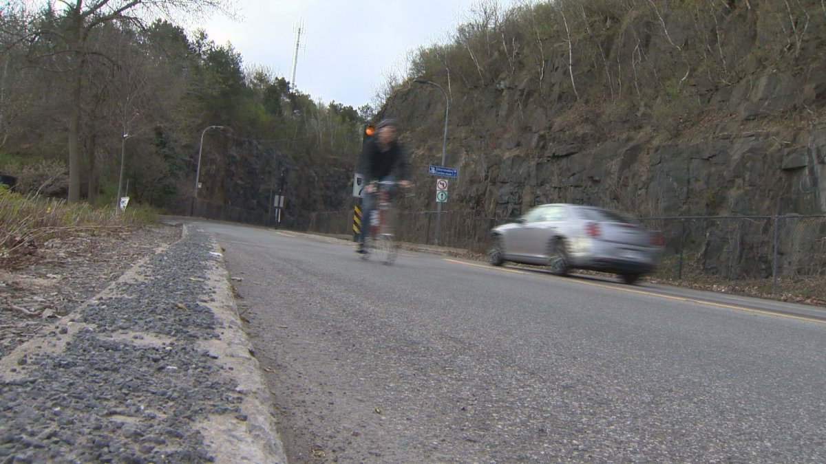 In this file photo, a cyclist can be seen on Camillien-Houde Way. The road which has been closed to through-traffic as part-of a five-month pilot project, will re-open on Thursday, Nov. 1.