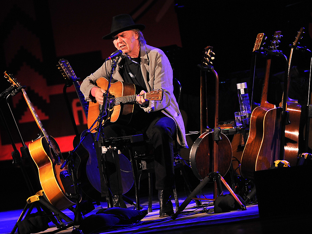 Neil Young performs at Massey Hall on January 12, 2014 in Toronto.