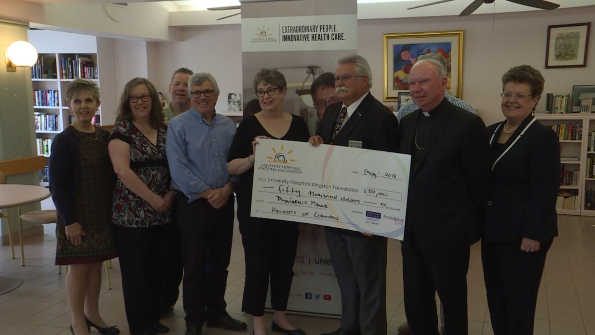 Knights of Columbus present a $50,000 cheque to Providence Care on Tuesday May 1.