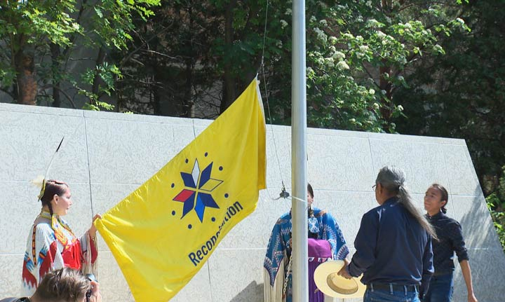 The flag raising was to honour victims and survivors of the '60s Scoop and residential schools.