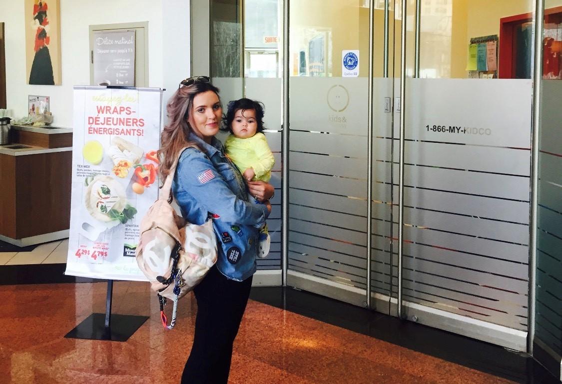Kawtar Afiri and her daughter, Sofia, stand outside the Kids & Company daycare.