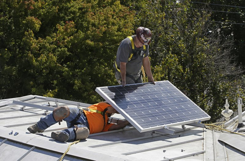 In this Oct. 16, 2015 file photo a solar panel is installed on the roof of a home.