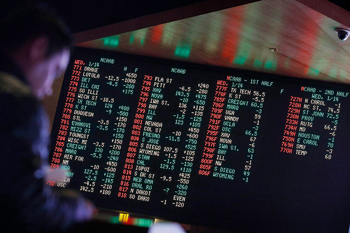 In this Jan. 14, 2015 file photo, odds are displayed on a screen at a sports book owned and operated by CG Technology in Las Vegas.