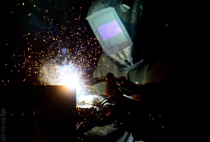 A welder fabricates a steel structure at an iron works facility in Ottawa on Monday, March 5, 2018.