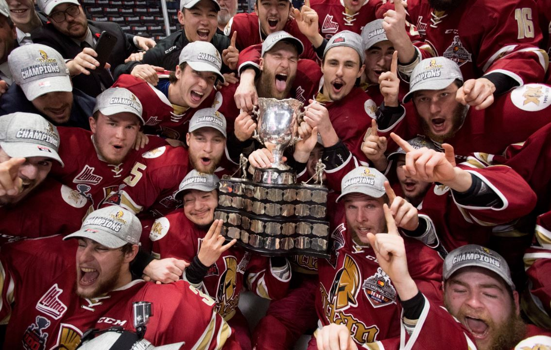 Members of the Acadie-Bathurst Titan pose with the Memorial Cup after defeating the Regina Pats in the Memorial Cup final in Regina on Sunday, May 27, 2018.