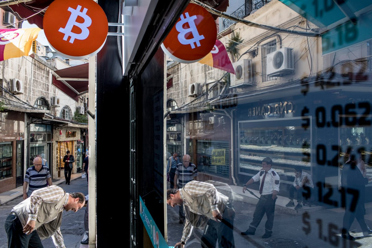 People walk in front of the first official Bitcoin exchange office in the Grand Bazaar in Istanbul, Turkey, 30 May 2018.