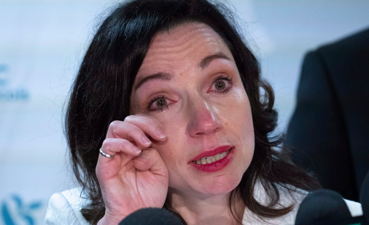 Martine Ouellet wipes a tear during a news conference in Montreal on Monday, June 4, 2018. Ouellet announced she is stepping down as head of the Bloc Québécois after a resounding defeat in a weekend leadership vote.