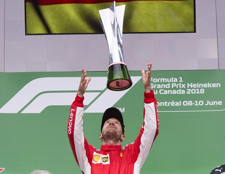Ferrari driver Sebastian Vettel of Germany celebrates after winning the Canadian Grand Prix Sunday, June 10, 2018 in Montreal.
