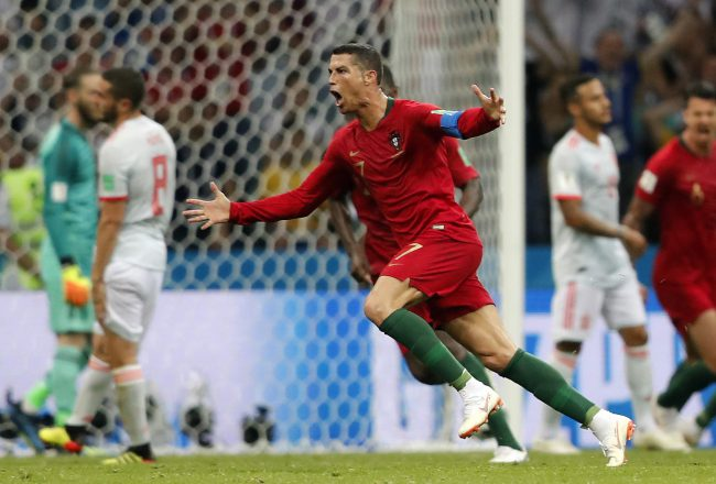 Portugal's Cristiano Ronaldo celebrates after scoring his third goal with a free kick during the Group B match between Portugal and Spain in FIFA World Cup action at the Fisht Stadium in Sochi, Russia, June 15, 2018.