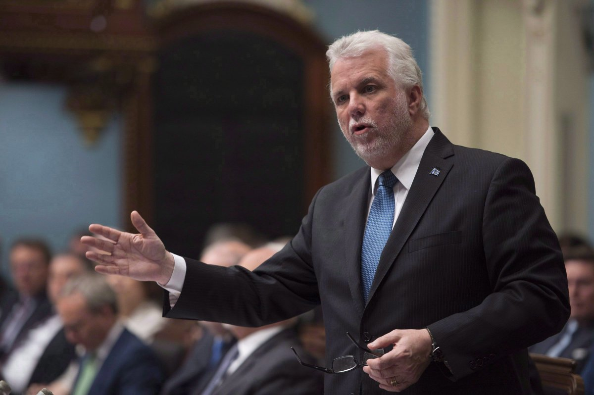 Quebec Premier Philippe Couillard responds to the oppositions over dairy farmers, Wednesday, June 13, 2018 at the legislature in Quebec City. Quebec Premier Philippe Couillard will be heading to the United States next week to push back against U.S. President Donald Trump's protectionist trade policies.