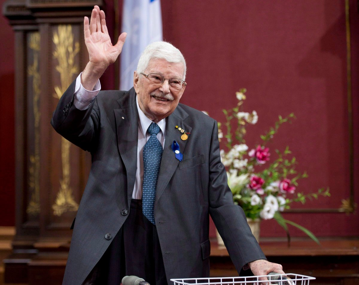 Former Quebec education minister Paul Gerin-Lajoie waves as he receives the George-Emile-Lapalme award at a ceremony for Les Prix du Quebec, Tuesday, November 12, 2013 at the legislature in Quebec City.