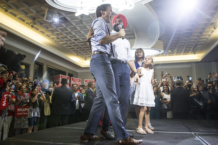 Prime Minister Justin Trudeau appears onstage with Liberal MP Navdeep Bains during a nomination event in Mississauga, Ont., on Wednesday, June 27, 2018. Bains is being nominated as the Liberal candidate for Mississauga-Milton for the 2019 general election.