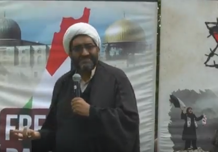 """Sheikh Shafiq Hudda, director of the Islamic Humanitarian Service, is pictured in this screenshot giving a speech at a Quds Day rally in Toronto on June 9 where he called for the """"eradication"""" of the state of Israel."""