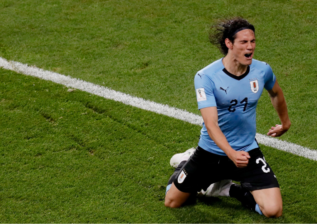 Edinson Cavani of Uruguay celebrates scoring the opening goal during the FIFA World Cup 2018 round of 16 soccer match between Uruguay and Portugal in Sochi, Russia, 30 June 2018.