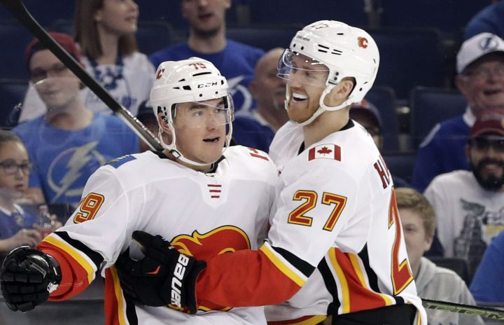 Calgary Flames left wing Micheal Ferland (79) celebrates his goal against the Tampa Bay Lightning with defenseman Dougie Hamilton (27) during the first period of an NHL hockey game Thursday, Jan. 11, 2018, in Tampa, Fla.