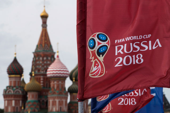 In this June 4, 2018, file photo, a flag with the logo of the World Cup 2018 on display with the St. Basil's Cathedral in the background, in Moscow, Russia.