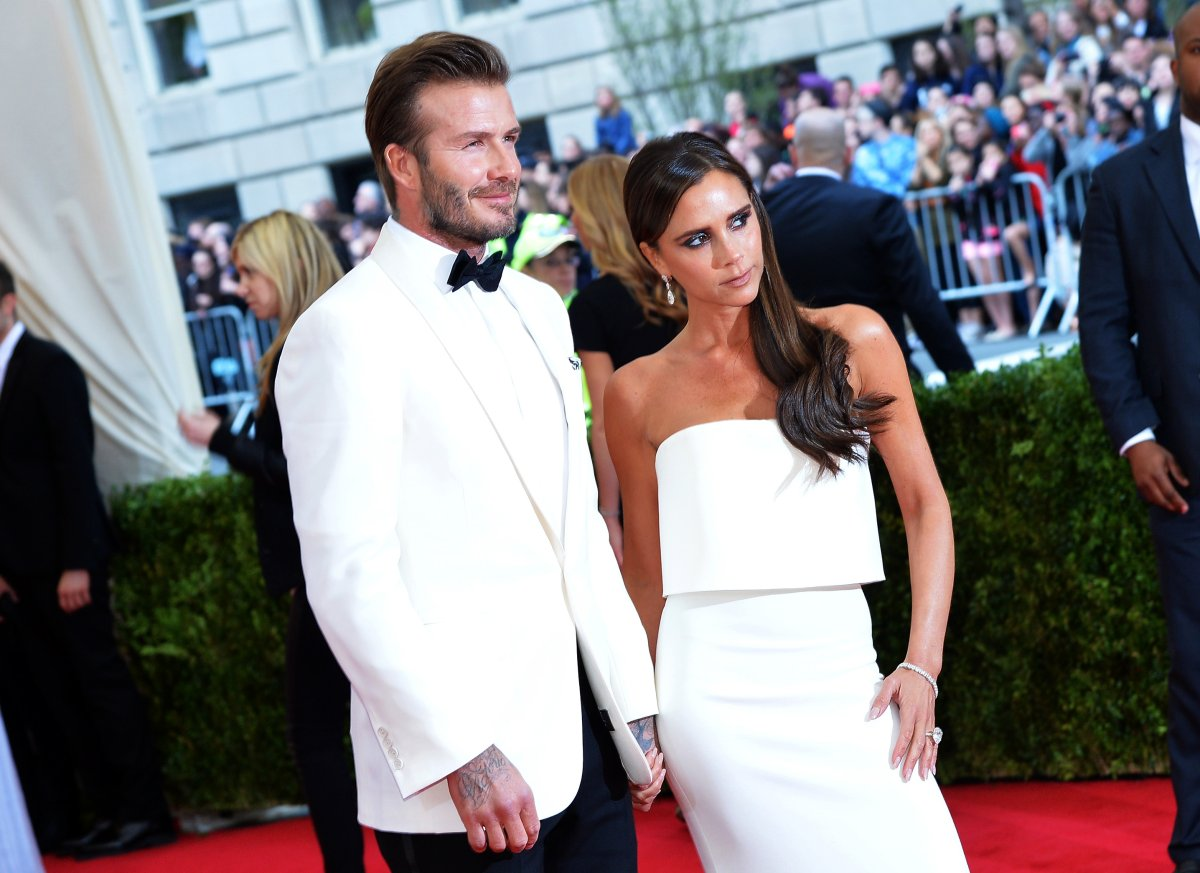 """David Beckham (L) and Victoria Beckham attend the """"Charles James: Beyond Fashion"""" Costume Institute Gala at the Metropolitan Museum of Art on May 5, 2014 in New York City."""