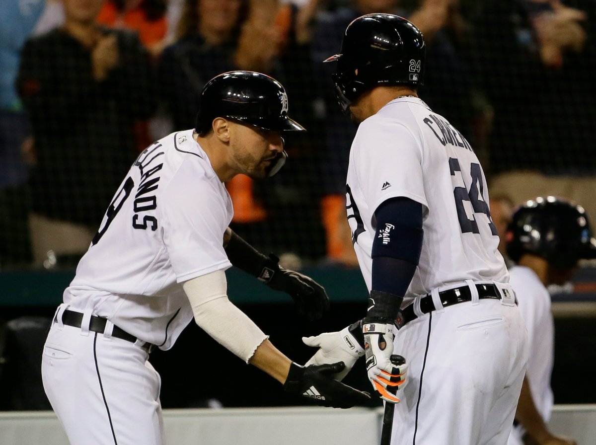 DETROIT, MI - JUNE 1:  Nicholas Castellanos #9 of the Detroit Tigers celebrates his solo home run against the Toronto Blue Jays with Miguel Cabrera #24 of the Detroit Tigers during the seventh inning at Comerica Park on June 1, 2018 in Detroit, Michigan. The Tigers defeated the Blue Jays 5-2.