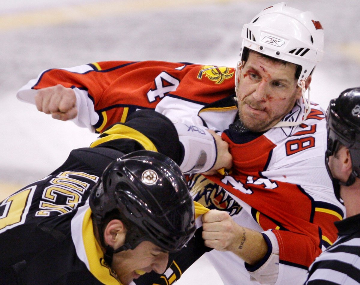Panthers defenseman Nick Boynton, right, throws a punch during a fight with Boston Bruins left wing Milan Lucic in Boston, Friday Nov. 21, 2008.