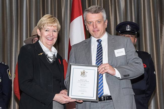 Attorney General and Minister of Justice Suzanne Anton, left, congratulates Vancouver Police Department Det. Const. Jim Fisher at the 16th annual Ministry of Justice Community Safety and Crime Prevention Awards in Burnaby on October 31, 2014 in this handout photo.
