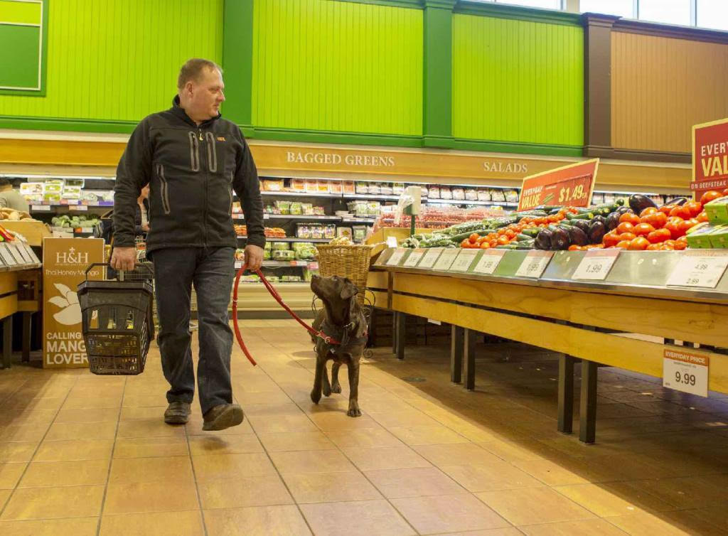 """Kevin Johnson is a former police officer who was prescribed a service dog to overcome his injuries and """"start living again""""."""