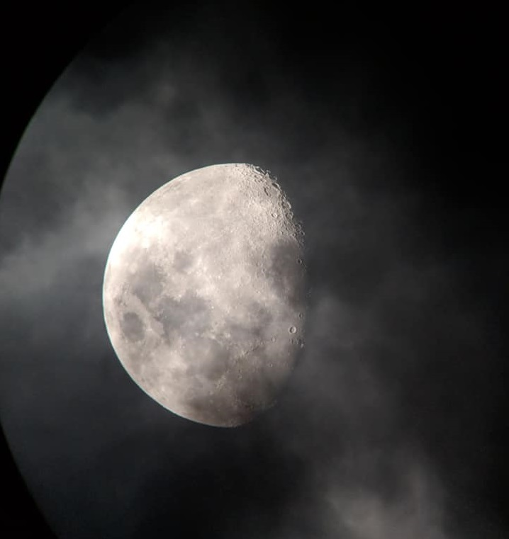 A picture of the moon taken through a telescope.