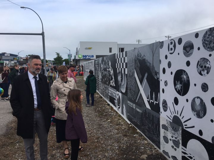 The community mural designed by Bowness High School students was unveiled  on June 11, 2018.