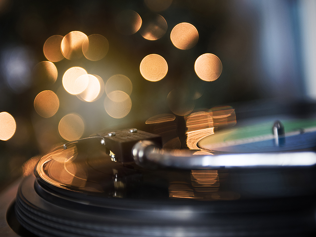 A close-up of a spinning record player.