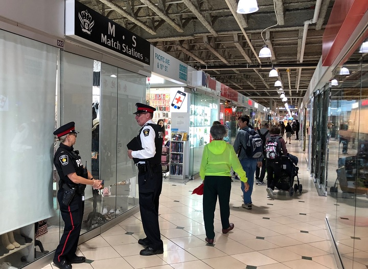 York Regional Police conduct raids at Pacific Mall in Markham, Ont., as part of a counterfeit goods investigation on June 27, 2018.
