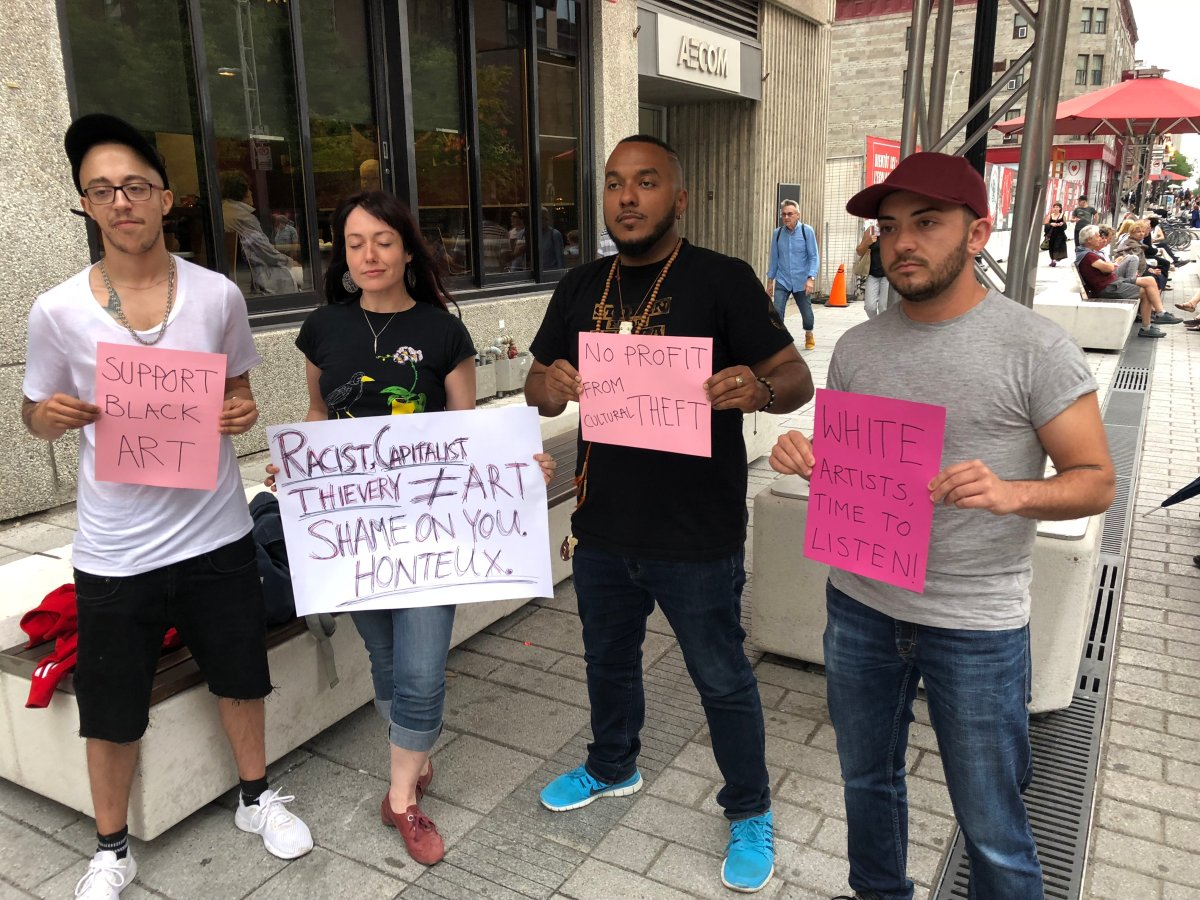 Protesters in front of the Theatre du Nouveau Monde in Montreal. Wednesday June 27, 2018.