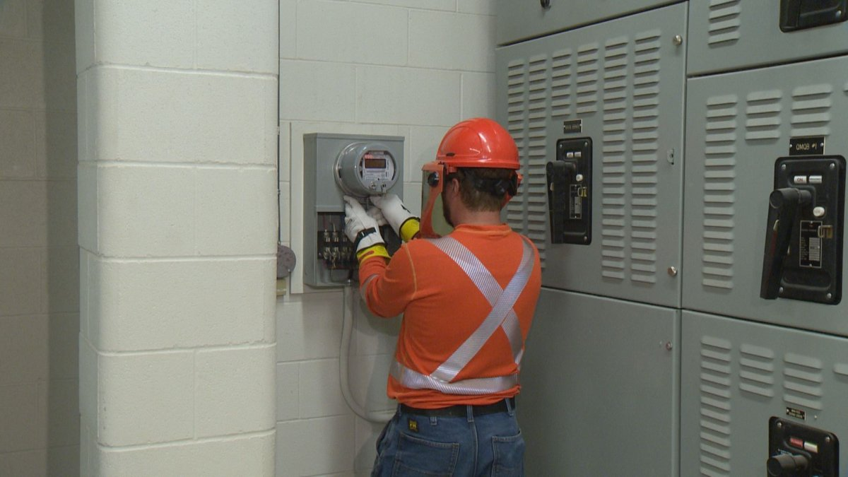 A SaskPower technician installs a new smart meter at one of their Regina facilities.