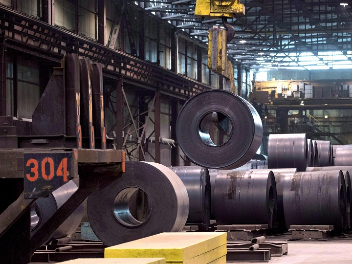 A coils of steel is moved by a crane at the Direct Strip Production Complex at Essar Steel Algoma in Sault Ste. Marie, Ont., on Wednesday, March 14, 2018. The Trump administration has hit Canada with big steel and aluminum tariffs.