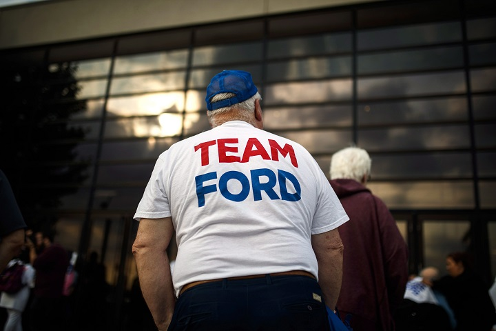 A man stands outside at the election night headquarters for Ontario PC Leader Doug Ford during the Ontario Provincial election night in Toronto, on Thursday June 7, 2018.