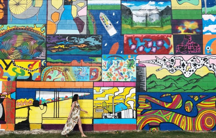 Linda Hoang in front of an Edmonton mural.