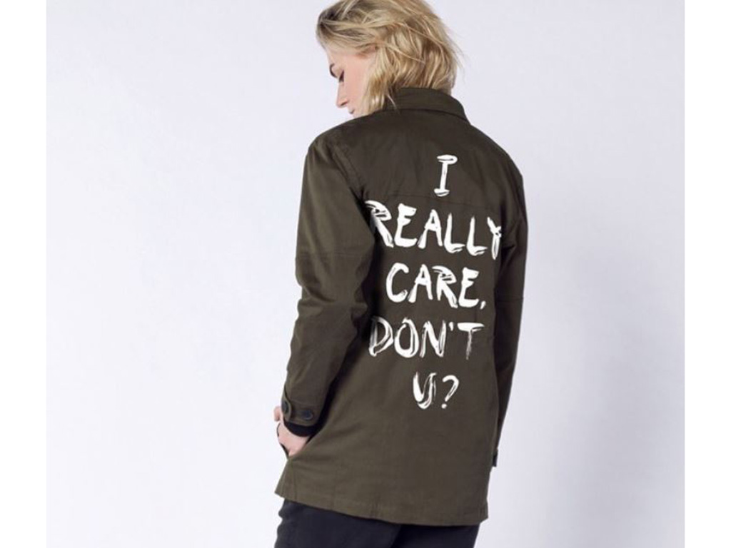 """Portland-based fashion label Wildfang has created a jacket in response to the one worn by Melania Trump that says, """"I really care."""" ."""
